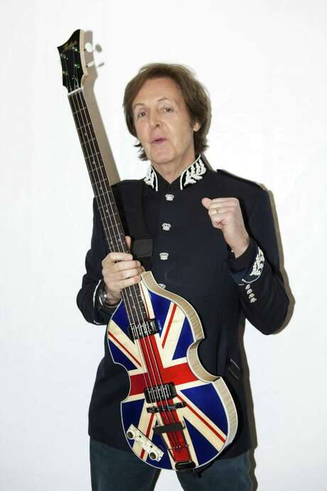 In this photo released by MPL Communications ,  Sir Paul McCartney with his specially created Union Jack Hofner Bass guitar specially made for his appearance  at the Diamond Jubilee concert at Buckingham Palace, in London Monday June 4, 2012.  (AP Photo / MJ Kim,  MPL Communications)NO SALES Photo: MJ Kim, HOEP / MPL Communications