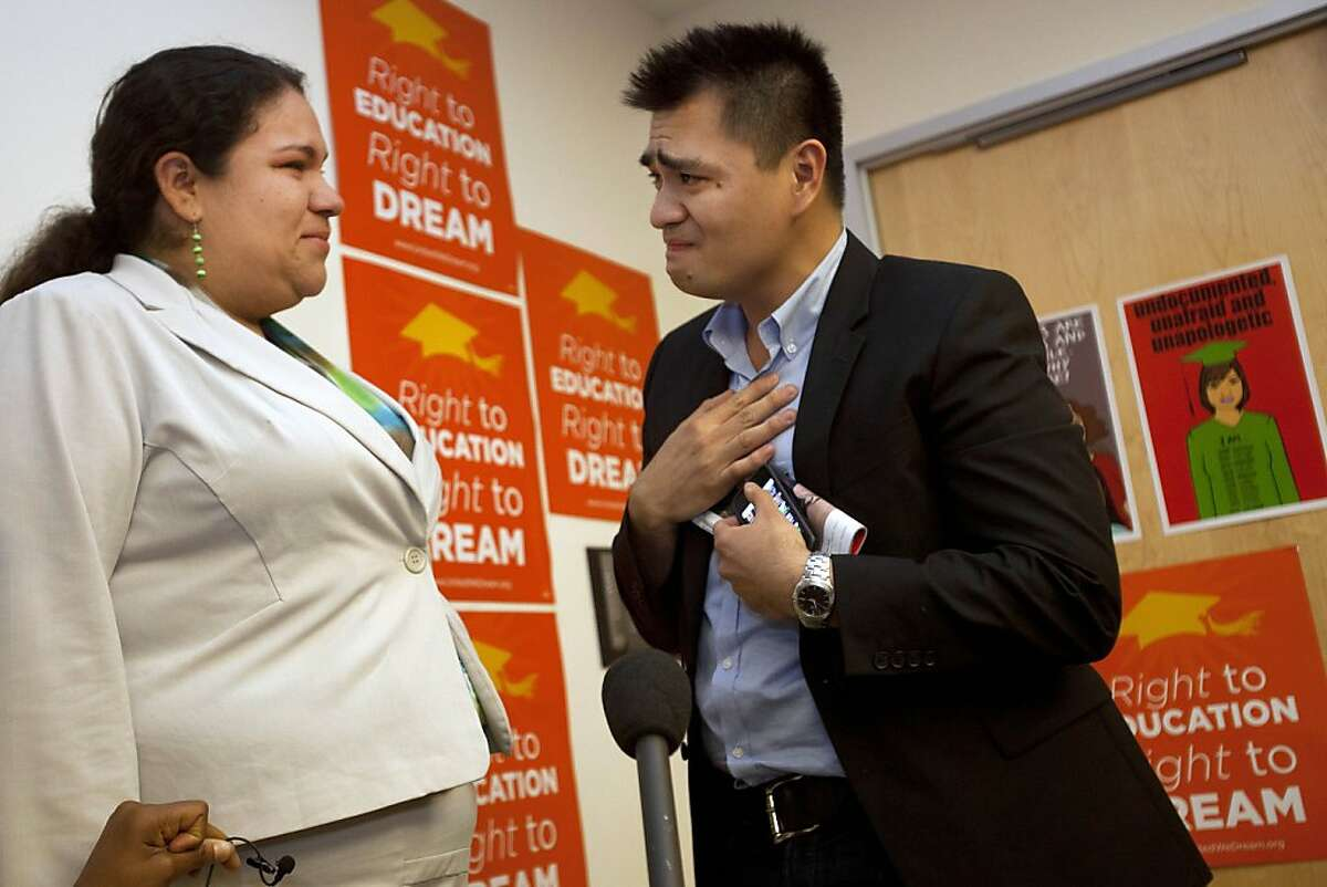 Former Washington Post journalist turned immigration reform activist, Jose Antonio Vargas, right, an illegal immigrant, is overcome with emotion speaking to Gaby Pacheco, 27, of Miami, an illegal immigrant originally from Ecuador, after watching President Obama announce that the U.S. government will stop deporting and begin granting work permits to younger illegal immigrants who came to the U.S. as children and have since led law-abiding lives, Friday, June 15, 2012, in Washington. (AP Photo/Jacquelyn Martin)