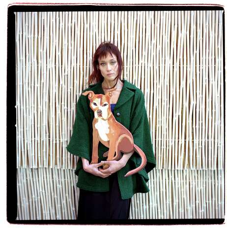 "Fiona Apple with a portrait by the artist Patrick Bucklew of her pit bull mix, Janet, in New York, April 6, 2012. Apple's new album, partly titled ""The Idler Wheel,"" her first since 2005, will be released on June 19. (Beatrice de Gea/The New York Times) - PHOTO MOVED IN ADVANCE AND NOT FOR USE - ONLINE OR IN PRINT - BEFORE JUNE 3, 2012. - Photo: BEATRICE DE GEA / NYTNS"