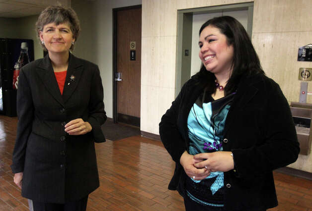 Benita Veliz (right) speaks with a reporter about the outcome of her hearing in immigration court Wednesday November 2, 2011. Veliz who was born in Mexico and went to school in the United States, found out that deportation proceedings against her have been dropped. She also found out she still can't legally work in the United States. Standing on the left is Veliz's attorney Nancy Taylor Shivers.  JOHN DAVENPORT/jdavenport@express-news.net Photo: SAN ANTONIO EXPRESS-NEWS
