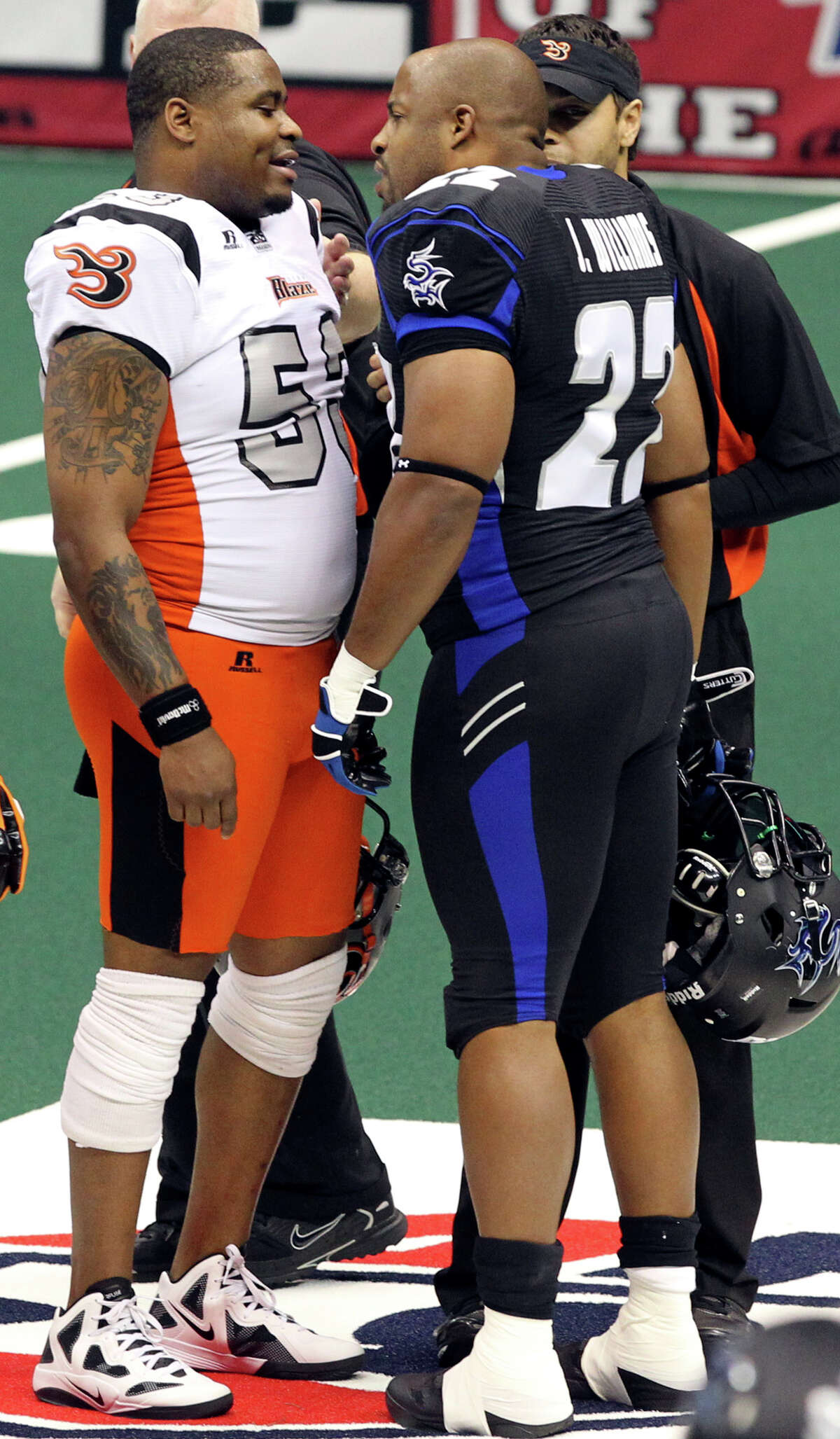 SPORTS Talons lineman John Williams has a disagreement with Mike Lewis before the game starts a the San Antonio Talons beat the Utah Blaze 54-48 at the Alamodome on March 10, 2012 Tom Reel/ San Antonio Express-News