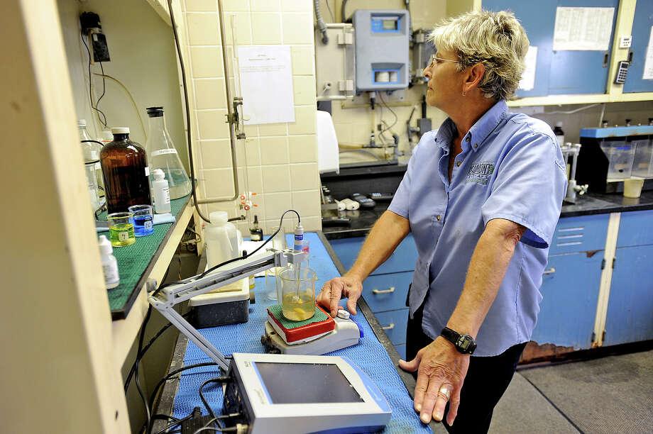 Cheryl Maywald tests water at the Beaumont Water Treatment plant on Thursday. Photo taken Thursday, June 14, 2012 Guiseppe Barranco/The Enterprise Photo: Guiseppe Barranco, STAFF PHOTOGRAPHER / The Beaumont Enterprise