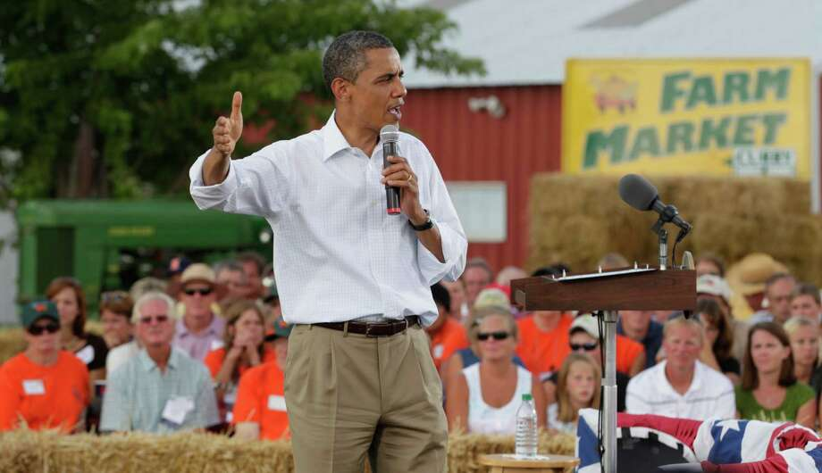 In this Aug. 17, 2011, photo, President Barack Obama speaks during a town hall meeting at Country Corner Farm Market in Alpha, Ill., during his three-day economic bus tour. Mitt Romney tells voters in small towns that he planted alfalfa on his uncle's farm as a teenager. And Obama doesn't hesitate to remind people in such far-flung places that his mother grew up in Kansas. So go the nostalgic pitches as each of the presidential candidates tries to connect with rural voters _ and convince them that only he can jump start a struggling economy. Photo: AP