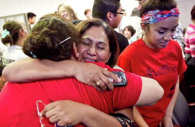 Rosa Maria Soto hugs Eva Monteloneo, right, after hearing President Obama is easing enforcement of immigration laws on Friday, June 15, 2012 in Phoenix.  The new policy offers a chance for hundreds of thousands of younger illegal immigrants to stay in the U.S. and work. (AP Photo/The Arizona Republic, Pat Shannahan)  MARICOPA COUNTY OUT; MAGS OUT; NO SALES Photo: AP