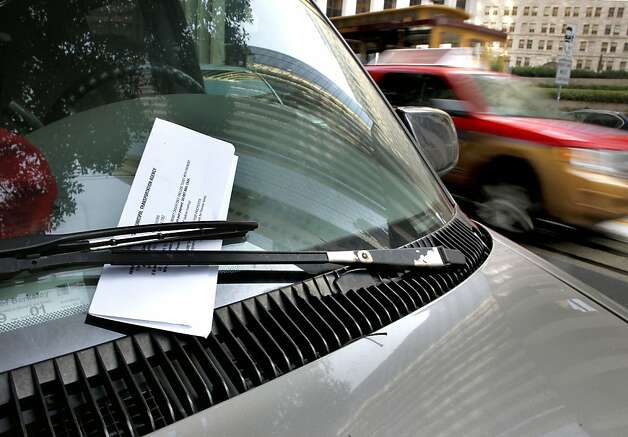 A parking citation on the windshield of a vehicle in the financial district on Thursday November 10, 2011 in San Francisco, Ca. The Municipal Transportation Agency is facing a $34 million deficit for next year and a $46 million deificit for the next year. Ideas to help erase that gap include charging riders who pay cash fares an extra 25 cents, and another 25 cents on top of that if they use a transfer. Also being considered is making drivers pay $3 more for parking fines and having parking meters fed on Sundays and later into the evenings and the idea to tack another $3 onto parking penalties was broached briefly over the summer and then shelved in the months leading up to the Tuesday mayoral election. Photo: Michael Macor, The Chronicle