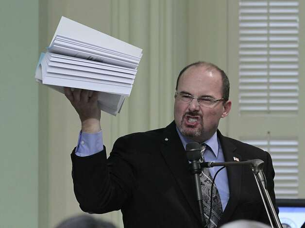 Assemblyman Tim Donnelly, R-Twin Peaks (San Bernardino County), holds up a copy of the state budget as he urges rejection of the 2012-13 spending plan. But the Democrats prevailed. Photo: Rich Pedroncelli, Associated Press
