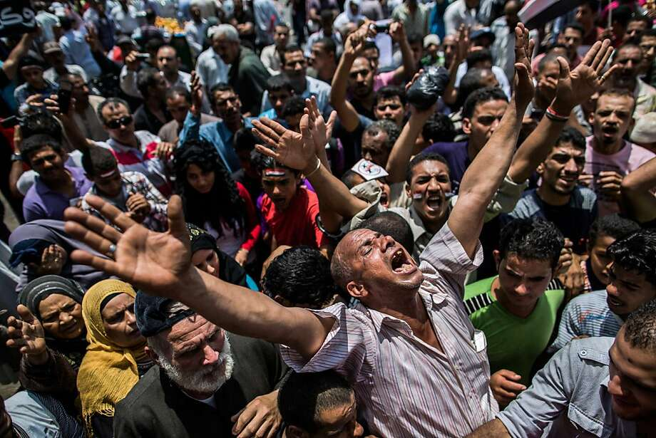 CAIRO, EGYPT - JUNE 15: Egyptians gather to protest in Tahrir Square on June 15, 2012 in Cairo, Egypt. Egypt's Supreme Constitutional Court ruled that the Islamist-led Parliament must be immediately dissolved, and also allowed the right of Hosni Mubarak's last prime minister, Ahmed Shafiq, to run for president. Egyptian candidates Mohamed Morsi and Ahmed Shafiq are pegged against each other in the second round of voting for the country's president to be held on the 16th and 17th of June.  (Photo by Daniel Berehulak/Getty Images)  *** BESTPIX *** Photo: Daniel Berehulak, Getty Images