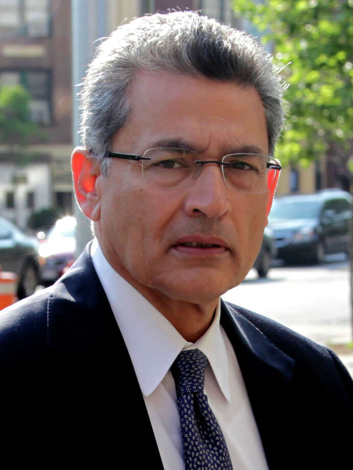 Rajat Gupta arrives at Manhattan federal court in New York, Tuesday, May 29, 2012. The former Goldman Sachs board member is accused of helping Raj Rajaratnam make millions of dollars through inside tips about Goldman Sachs and Procter & Gamble Co. Gupta sat on the boards of both companies when prosecutors say he fed the information in 2007 and 2008. Defense lawyers say his comments were already widely discussed publicly by Goldman executives. Photo: AP
