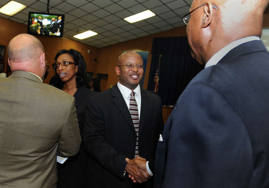Timothy Chargois shakes hands with Carrol Thomas after signing a contract with the Beaumont Independent School District to be the next superintendent as of January 2013. The contract extends to June 30 of 2016 and offers $215,000 per year to Chargois. Photo taken Tuesday, May 1, 2012 Guiseppe Barranco/The Enterprise Photo: Guiseppe Barranco, STAFF PHOTOGRAPHER / The Beaumont Enterprise
