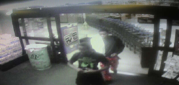 Surveillance video from Kroger on Phelan showing two boys suspected of using coins stolen from around 70 cars in a change machine early Friday morning.  Photo provided by Beaumont Police Photo: Guiseppe Barranco, STAFF PHOTOGRAPHER / The Beaumont Enterprise