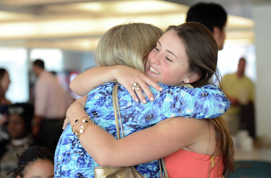 Graduate Jessica Raimondi hugs Special Education teacher Susan Martin during the Alternate Routes to Success (ARTS) Program graduation at the Patio Cafe located in the Stamford Government Center on Thursday, June 14, 2012. Photo: Amy Mortensen / Connecticut Post Freelance