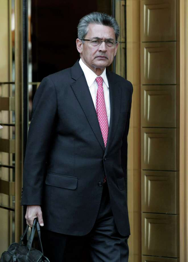 Former Goldman Sachs director Rajat Gupta leaves federal court in New York, Friday, June 15, 2012. Gupta, accused of feeding confidential information to a corrupt hedge fund manager, has been convicted of conspiracy and three counts of securities fraud. (AP Photo/Richard Drew) Photo: Richard Drew