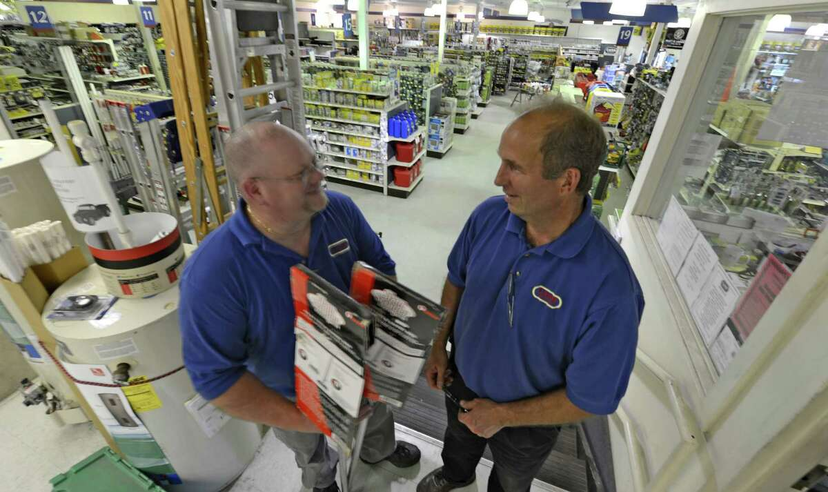 Dan Kays, store manager, left speaks with Dave Paris, corporate vice president at the Carr Hardware store in Watervliet, N.Y. June 15, 2012. Carr Hardware is closing this store. (Skip Dickstein/Times Union).
