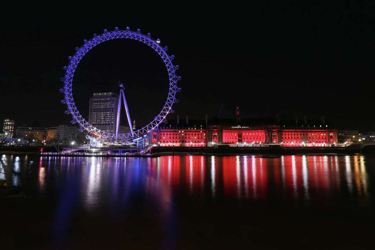 The London Eye, at 443 feet high, is tallest Ferris wheel in the Western Hemisphere. It opened in 1999. It's seen here illuminated on the banks of the River Thames in London, England.