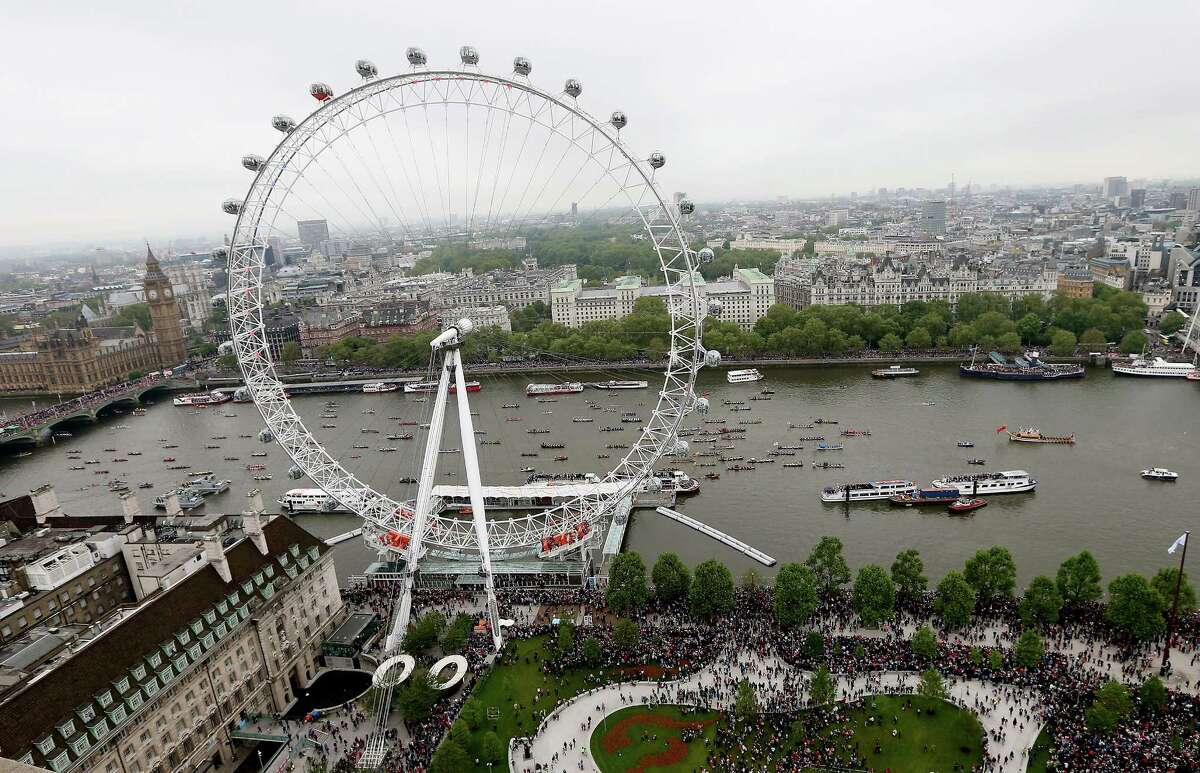 There are now taller wheels than the London Eye, but it's still described as the world's tallest cantilevered wheel, meaning it's supported by an A-frame on just one side of the wheel. It's pictured here during England's Diamond Jubilee on June 3.
