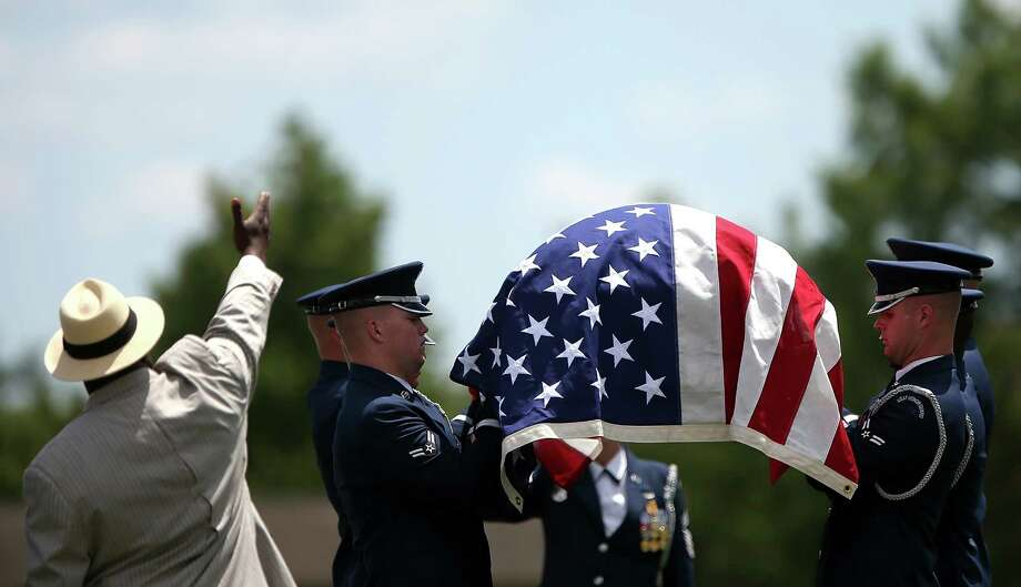 An Air Force honor guard team carries the casket of U.S. Air Force Lt. Col. Charles M. Walling, during his burial service June 15, 2012 at Arlington National Cemetery in Arlington, Virginia. Walling, of Phoenix, Arizona, crashed August 8, 1966 during a mission over Song Be Province, Vietnam. His remains were located in 2010. Photo: Win McNamee, Getty Images / 2012 Getty Images