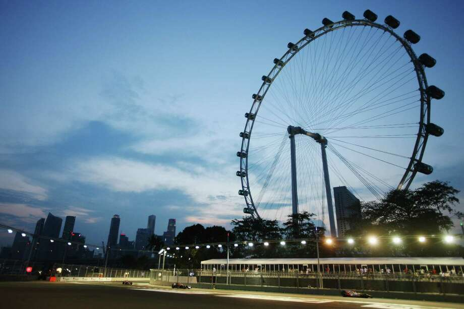The Singapore Flyer is the world's tallest Ferris wheel at 541 feet high. Soon after it opened in 2008, the direction of the wheel's rotation was reversed, because feng shui experts said the wheel was taking fortune away from the city. The capsules originally rose over the business district and descended over the sea. Photo: Mark Thompson, Getty Images / 2008 Getty Images
