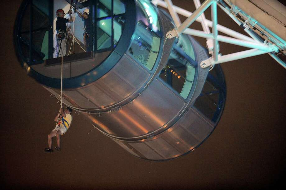 Soon after the Singapore Flyer opened in 2008, passengers had to be rescued during a mechanical breakdown. Photo: ROSLAN RAHMAN, AFP/Getty Images / 2008 AFP