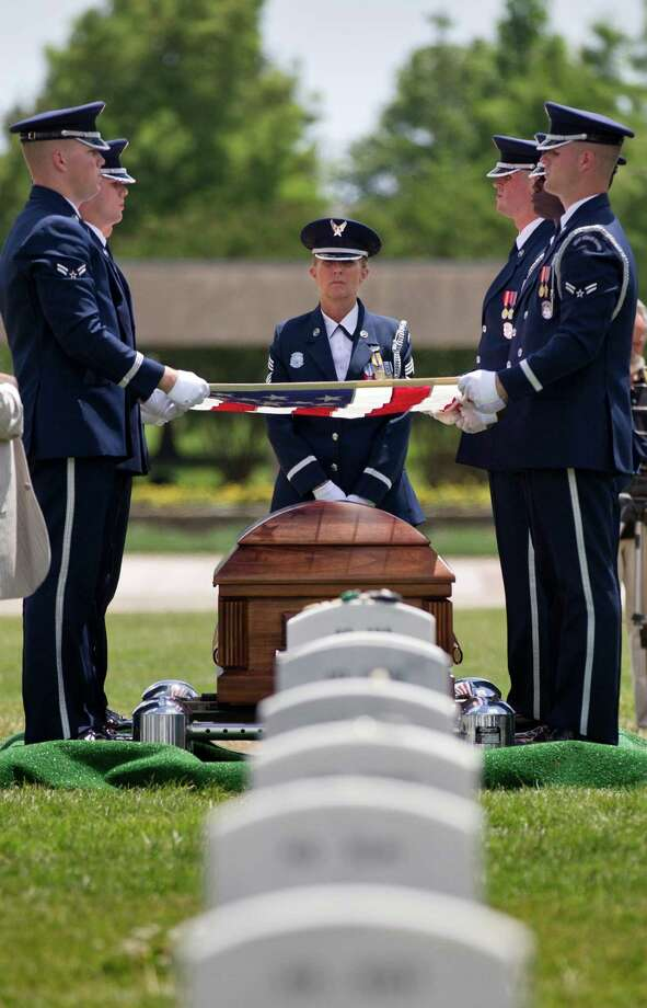 Air Force Lt. Col. Charles M. Walling of Phoenix, whose F-4 Phantom jet crashed during a mission in Vietnam in 1966, is buried with full military honors at Arlington National Cemetery in Arlington, Va., Friday, June 15, 2012. Walling's remains were recovered in 2010. Photo: J. Scott Applewhite, Associated Press / AP