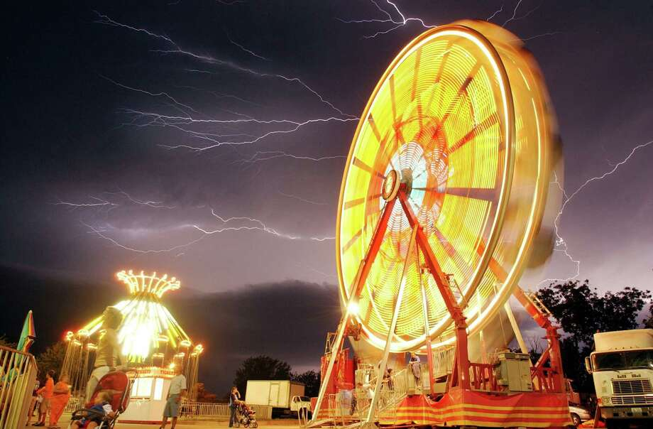 A cool picture of lightning behind a Ferris wheel at the Texas Oklahoma Fair on Sept. 14, 2005. Photo: Jason Palmer, Wichita Falls Times Record News / AP