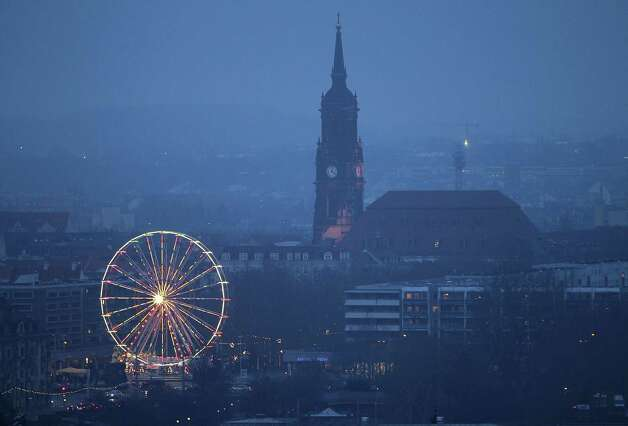 A Ferris wheel anchors the Dresden Striezelmarkt Christmas market, said to be Germany's oldest Christmas market. It dates back to 1434. Photo: Sean Gallup, Getty Images / 2010 Getty Images