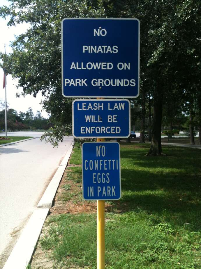 Signs banning piñatas, like this one erected in Meyer Park after Harris County adopted a new anti-litter policy six years ago, should be down by Wednesday. Photo: Lisa Gray / Houston Chronicle