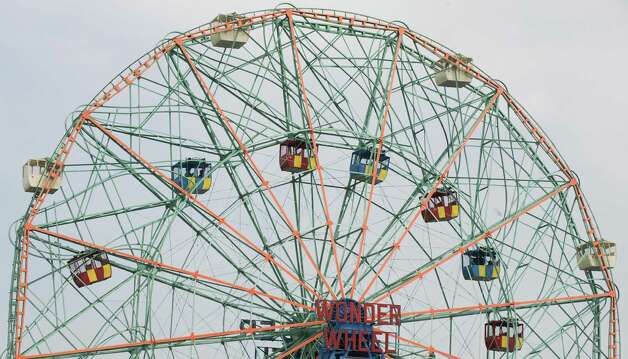 "The Wonder Wheel is a ""sliding"" or ""coaster"" wheel, in which the inner cars slide between the hub and rim. Photo: DON EMMERT, AFP/Getty Images / 2009 AFP"