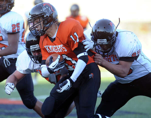 Eric Knight carries the ball during Friday's Spring Football Game at Stamford High School on June 15, 2012. Photo: Lindsay Niegelberg / Stamford Advocate