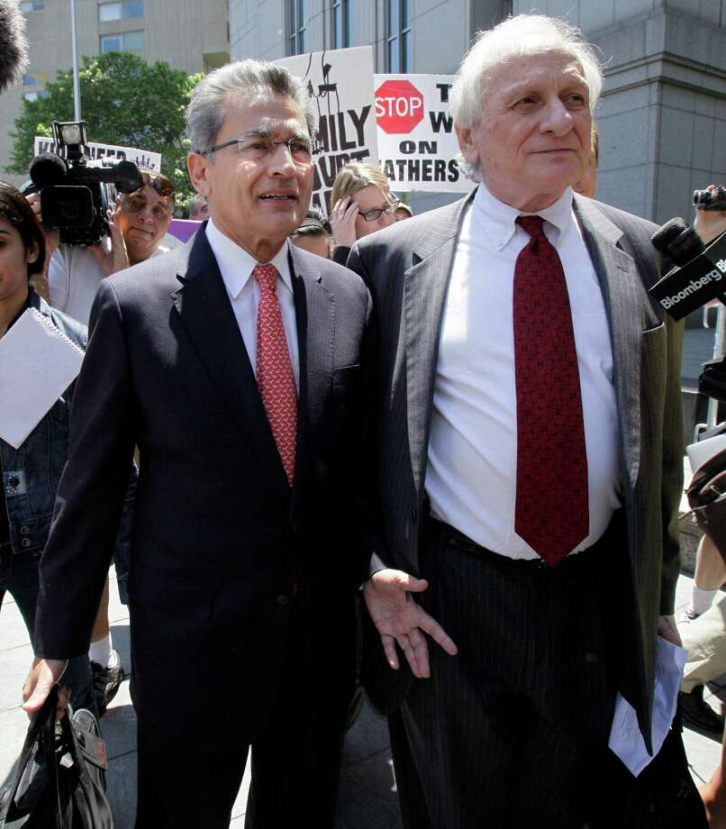 Former Goldman Sachs director Rajat Gupta, left, and his attorney Gary P. Naftalis, leave federal court in New York, Friday, June 15, 2012. Gupta, accused of feeding confidential information to a corrupt hedge fund manager, has been convicted of conspiracy and three counts of securities fraud. (AP Photo/Richard Drew) Photo: Richard Drew, AP / AP