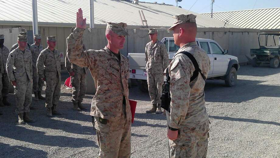 Marine Corps Kenneth Richardson is promoted to major by Col. Phillip M. Bragg, commander of 2nd battalion, 10th Marines, during a ceremony at Camp Leatherneck in Afghanistan on June 1.