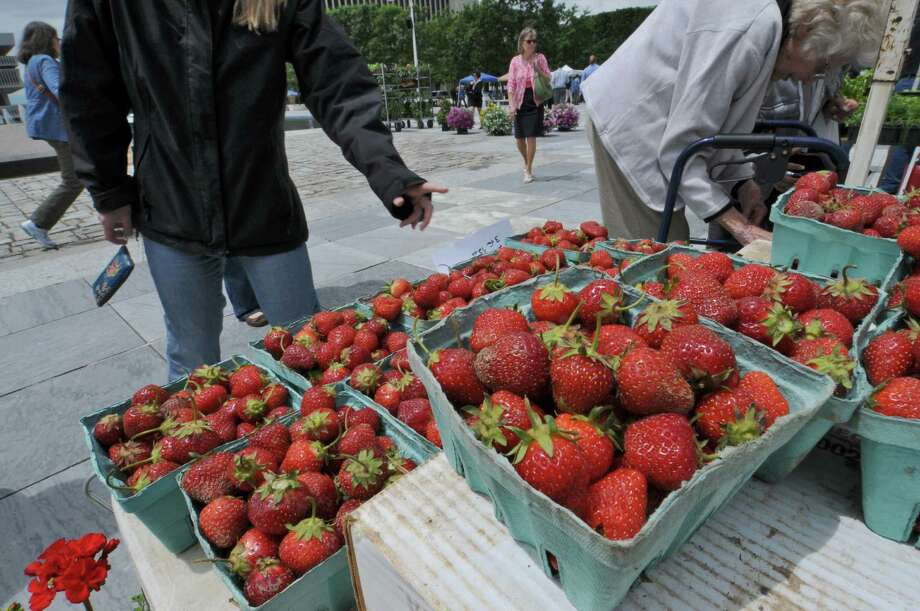 Fresh strawberries are for sale by Bulich Creekside Farm, of Leeds, at the farmers' market on the Empire State Plaza on Wednesday June 6, 2012 in Albany, NY.  Access to farmer's markets would improve under a bipartisan farm bill that U.S. Senators Charles Schumer and Kirsten Gillibrand are working on .(Philip Kamrass / Times Union ) Photo: Philip Kamrass / 00017991A