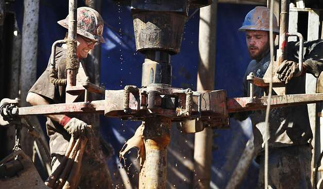 "FILE - In this Feb. 21, 2012, file photo, oil field workers drill into the Gypsum Hills near Medicine Lodge, Kan., using horizontal drilling and a technique known as hydraulic fracturing, or ""fracking,"" to coax out oil and gas. Illinois legislation is advancing that would regulate decades-old but debated technology used to reach previously inaccessible natural gas reserves deep underground.  The Illinois state Senate on Thursday, April 26, 2012, unanimously sent to the House a bill addressing hydraulic fracturing, or fracking. That technology involves using mixtures of water, sand and chemicals to free below-ground energy reserves. (AP Photo/Orlin Wagner, File) Photo: Orlin Wagner, Associated Press"