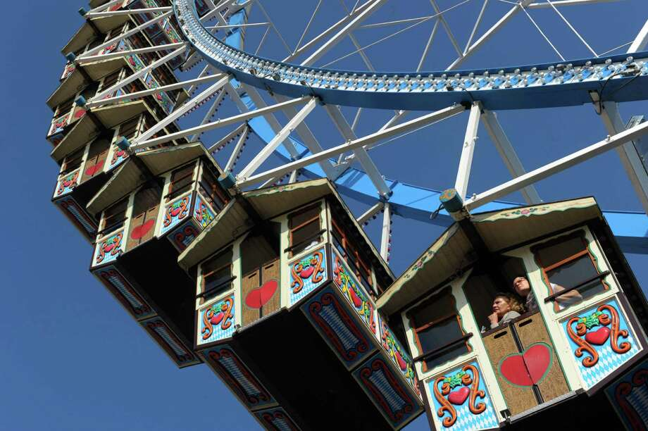 Where can you ride a Ferris wheel in little Hansel-and-Gretel-like houses? At Oktoberfest in Munich, Germany. Photo: CHRISTOF STACHE, AFP/Getty Images / 2011 AFP