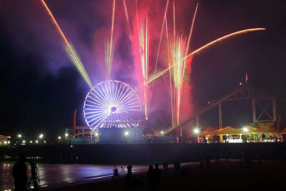 The Santa Monica Pier debuted a new, $1.5-million, solar-powered Ferris wheel in 2008, replacing its old wheel that was built in 1996. The new wheel stands 85 feet high and is equipped with 160,000 LED lights for some pretty cool evening displays. Photo: David McNew, Getty Images / 2008 Getty Images