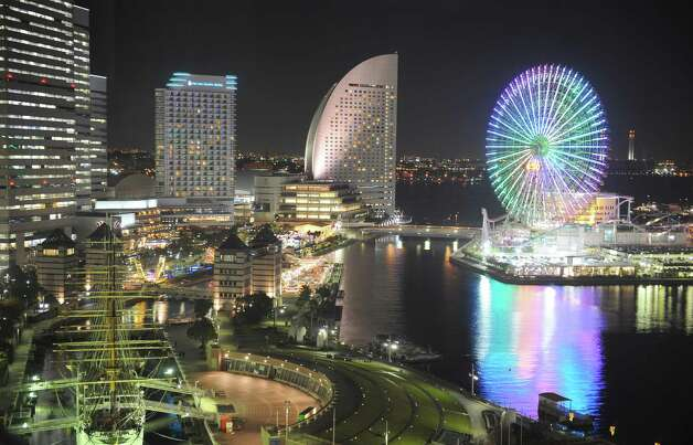 The Cosmo Clock 21, in Yokohama, Japan, was the world's tallest Ferris wheel when it opened in 1989. It was relocated a decade later to a taller base, making its current height of 369 feet. It still has the world's largest clock. Photo: ALEXANDER NEMENOV, AFP/Getty Images / 2010 AFP