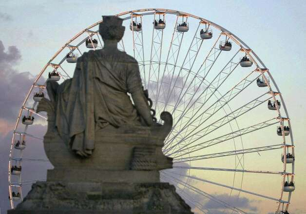 Every winter, a Ferris wheel opens at the Place de la Concorde in Paris, the site of one of the most famous transportable wheels -- the 197-feet Roue de Paris, a ride installed at the site for the 2000 millennium. Photo: GABRIEL BOUYS, AFP/Getty Images / 2005 AFP