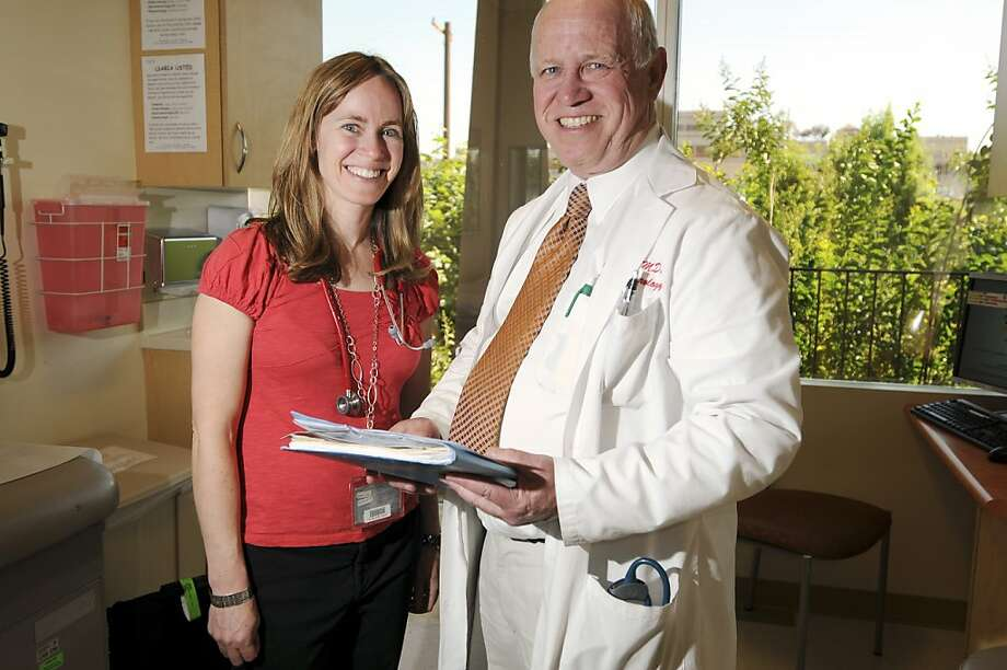 Dr. William Berquist, right, and daughter Dr. Rebecca Berquist McKenzie, pose for a photo Wedneday, June 13, 2012. Both are pediatric gastroenterologists at Lucile Packard Children's Hospital in Palo Alto, Calif. Photo: Erik Verduzco, Special To The Chronicle