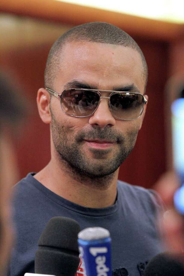 French basket-ball player Tony Parker answers journalists' questions on June 15, 2012 in Paris, before taking part in the preparation of the French basket-ball team for the 2012 London Olympics Games. AFP PHOTO/THOMAS SAMSON        (Photo credit should read THOMAS SAMSON/AFP/GettyImages) Photo: AFP, AFP/Getty Images / 2012 AFP