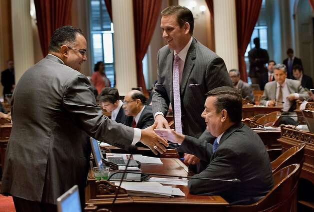 Assembly Speaker John Perez shakes hands with State Senator Tony Strickland, center, and State Senator Joel Anderson following the senate budget vote at the State Capitol in Sacramento, California, on Friday, June 15, 2012. (Randall Benton/Sacramento Bee/MCT) Photo: Randall Benton, McClatchy-Tribune News Service
