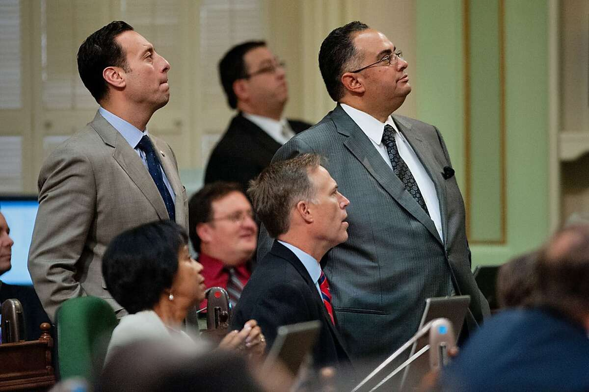 California State Assembly members, including Assembly Speaker John Perez, right, watch the results of voting on the state's budget at the State Capitol in Sacramento, California, on Friday, June 15, 2012. (Randall Benton/Sacramento Bee/MCT)
