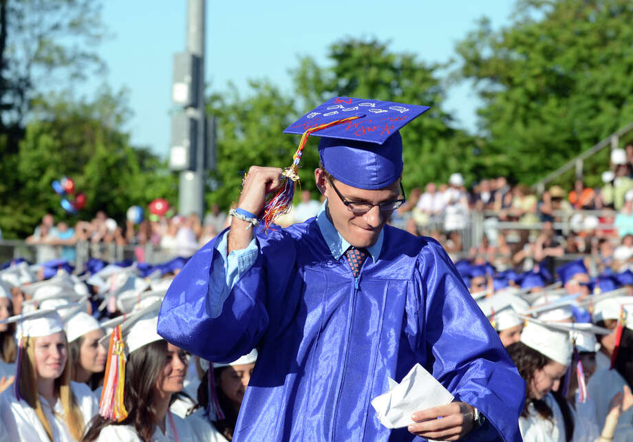 Christopher Madaffari, Senior Class President and Salutatorian, celebrates as he walks up to the podium to address his classmates during the fifty-first commencement excercises at Brien McMahon High School in Norwalk on Friday, June 15, 2012. Photo: Amy Mortensen / Connecticut Post Freelance