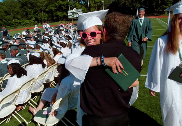 Graduate Ashley Williamson hugs her physics teacher Glenn Couture, during Norwalk High School's Class of 2012 Commencement Ceremony in Norwalk, Conn. on Friday June 15, 2012. Photo: Christian Abraham / Connecticut Post