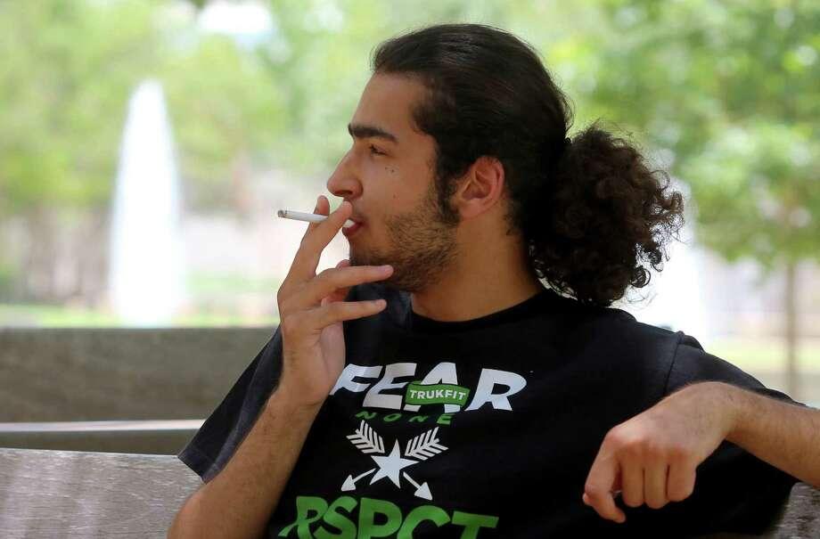 UH business major Muklhef Alshammari won't be puffing cigarettes on campus this fall if a proposal to ban smoking is approved. Photo: Thomas B. Shea / © 2012 Thomas B. Shea