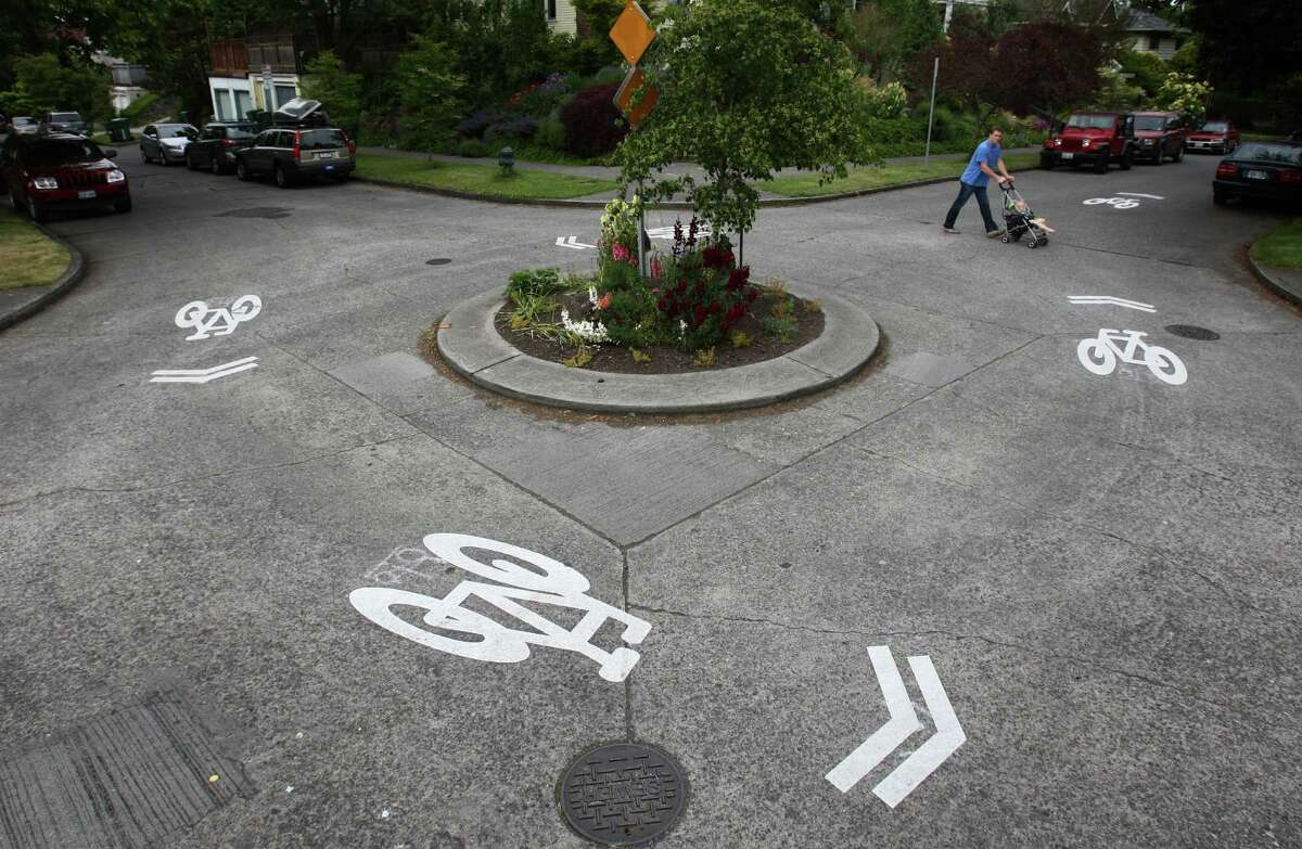 Bike sharrows mark the road in Wallingford as Seattle's first neighborhood greenway is set to have its ceremonial opening. Seattle's Neighborhood Greenways project aims to calm streets and make them friendlier to pedestrians and bicycle riders. Photographed on Friday, June 15, 2012.