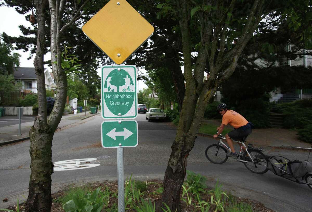 A bicycle rider pedals in Wallingford as Seattle's first neighborhood greenway is set to have its ceremonial opening.