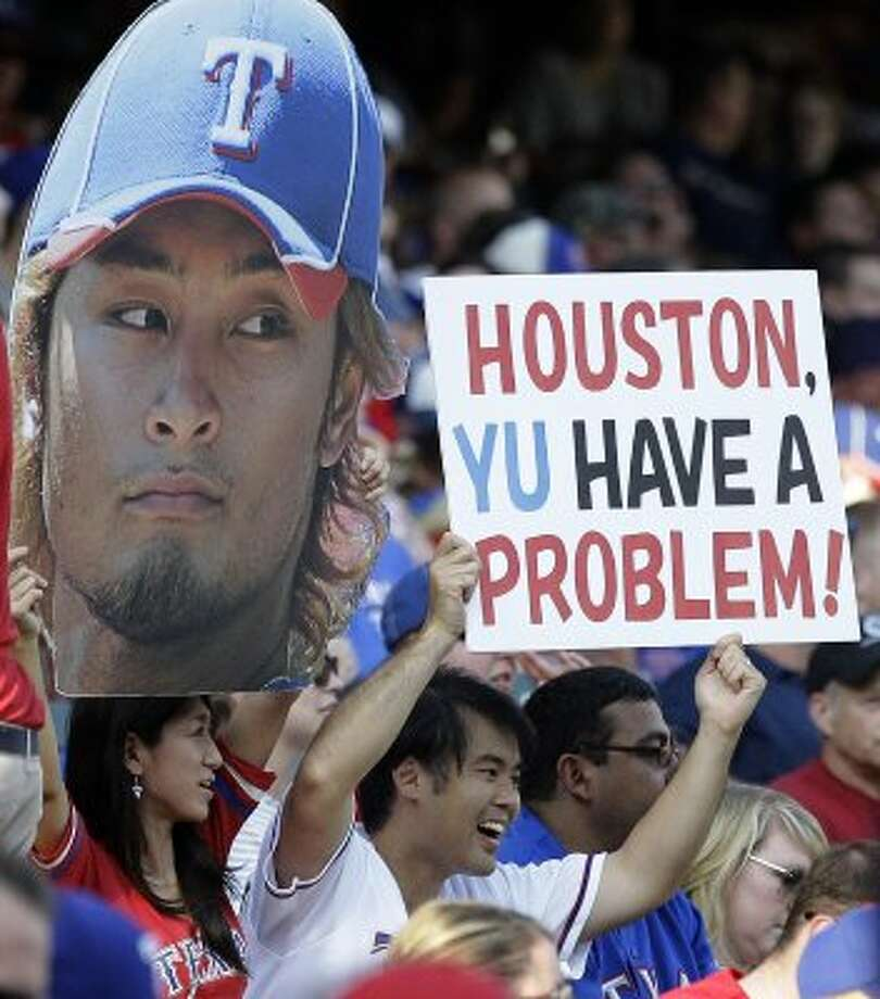 Fans show their support for Rangers starting pitcher Yu Darvish during the series opener against the Astros.  (LM Otero / Associated Press)