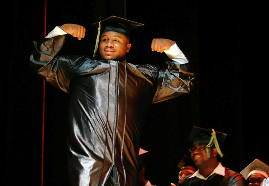 Graduate Rashid Williams Jr. comes up for his diploma flexing his muscles, durnig Bridge Academy's Class of 2012 Commencement Exercises in Bridgeport, Conn. on Friday June 15, 2012. Photo: Christian Abraham / Connecticut Post