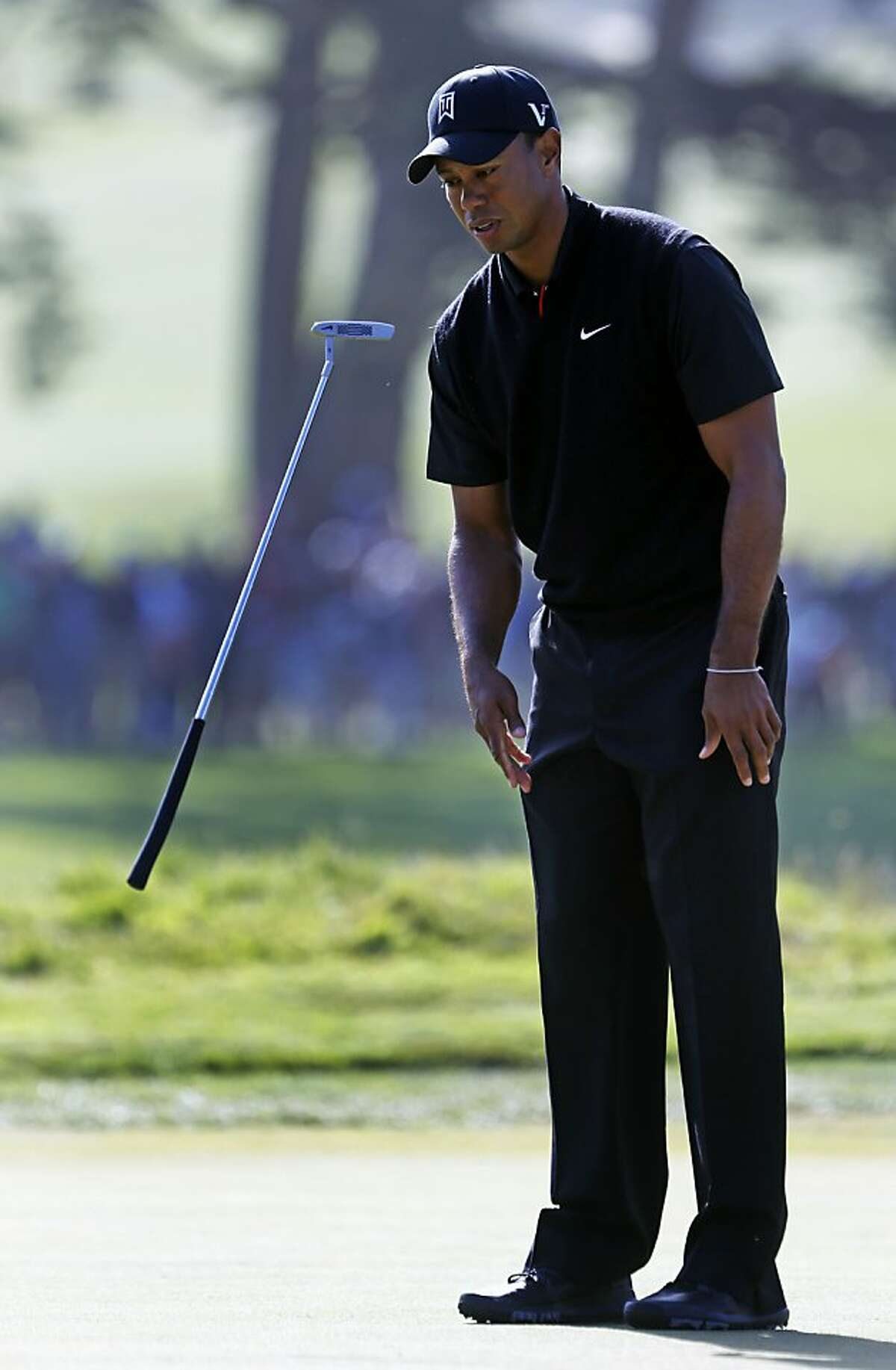 Tiger Woods flips his putter after missing a birdie shot on the 16th green during the second round of the 112th U.S. Open at The Olympic Club on Friday June 15, 2012 in Daly City, California.
