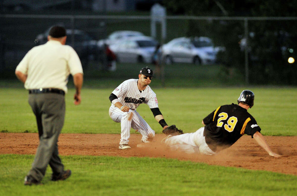 Danbury shortstop Josh Ake applies the tag on North Adams' Charlie Law finishing a double play during their game at Rogers Park in Danbury on Friday, June 15, 2012. North Adams won, 3-2.