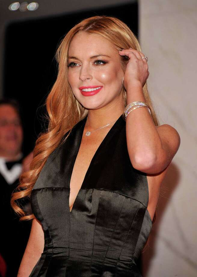 """Lindsay Lohan- """"WHY is everyone in SUCH a panic about hurricane (i'm calling it Sally)…? Stop projecting negativity! Think positive and pray for peace."""" Photo: Stephen Lovekin / 2012 Getty Images"""